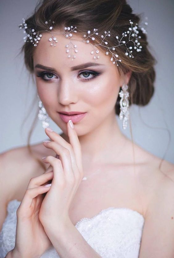 Wedding hairstyles with a diadem falling to the forehead